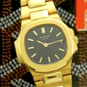 Patek Philippe Nautilus ref 4700:1 18k yellow gold with extract of archive1
