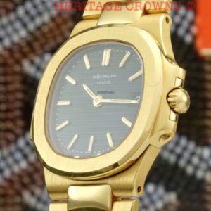 Patek Philippe Nautilus ref 4700:1 18k yellow gold with extract of archive2